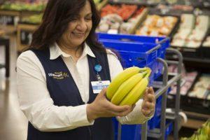 Image: Walmart | Associate Picks Bananas for Pick-Up Customer