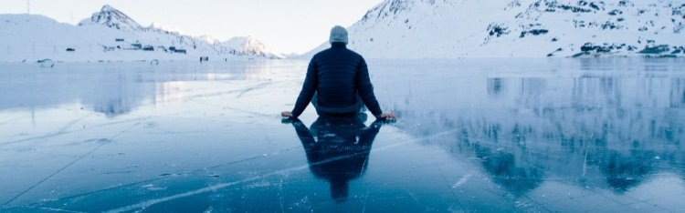 man contemplating alone outside on ice