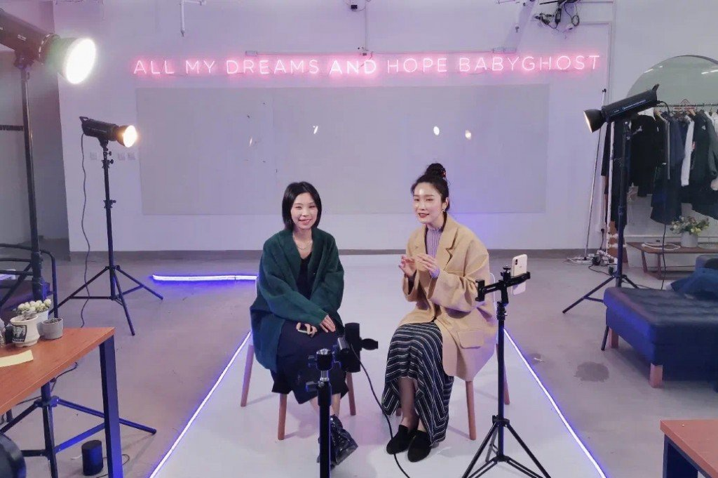 Babyghost co-founder Qiaoran Huang (right) talks to viewers in a livestream session ahead of their showcase.